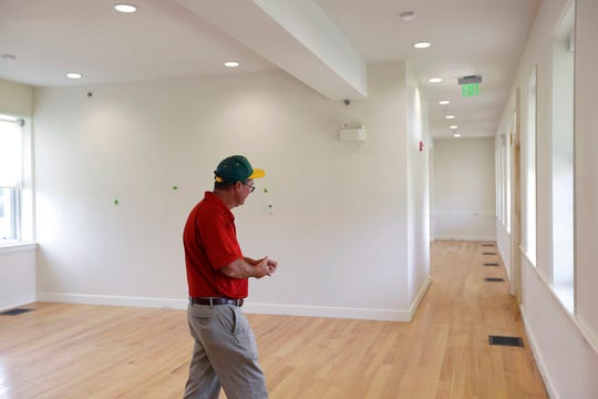 Tinicum township board president Patrick McCarthy walks through a room in the refurbished Lazaretto Quarantine Station.