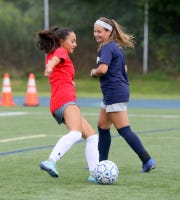 Leila Vargas, left, and Ellie Mustico share a laugh during Elmira Notre Dame girls soccer practice Aug. 22, 2019 at Brewer Memorial Stadium.