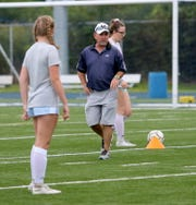 Elmira Notre Dame girls soccer head coach Steve Weber directs players during practice Aug. 22, 2019 at Brewer Memorial Stadium. Weber is co-head coach with his son, Kevin Weber.