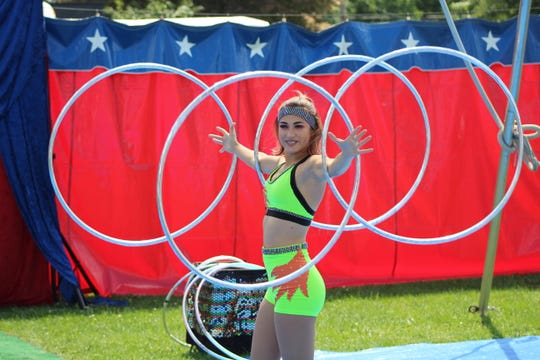 Ariana Alvarez uses hula hoops to perform for Cirque Mundia at the Sandusky County Fair.
