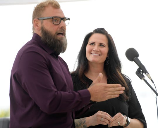 Barry Karcher speaks on his experiences on a History Channel survival show beside his wife Constance Karcher during The Coloradoan's Storytellers Project at Spring Canyon Community Park in Fort Collins, Colo. on Wednesday, August 21, 2019.