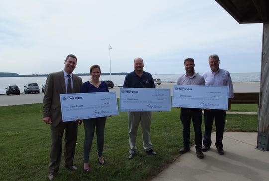 Wisconsin Department of Administration Secretary Joel Brennan and Rep. Joel Kitchens pose with Coastal Management Program grant recipients in Sturgeon Bay Tuesday.