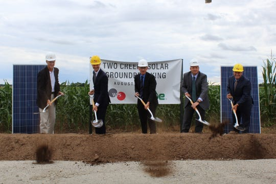 Mike O'Sullivan, senior vice president for NextEra Energy Resources; Tom Metcalfe, WPS president; Gov. Tony Evers; MGE president and CEO Jeff Keebler; and WEC Energy Group CEO Kevin Fletcher break ground at Two Creeks Solar Park on Thursday, August 22, 2019.