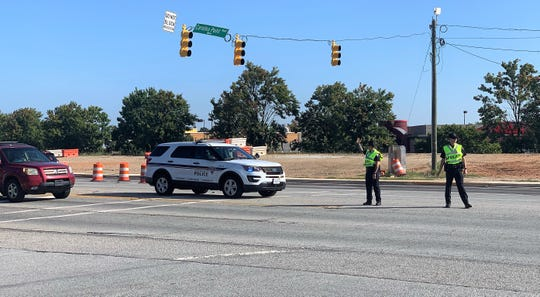 Police direct traffic in Greenville after an early morning wreck knocked out power to traffic lights.
