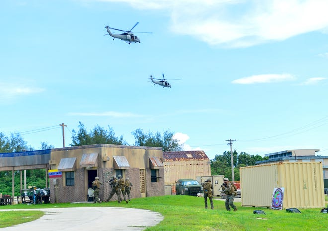 Marines assigned to Force Reconnaissance Company, III Marine Expeditionary Force, conduct a limited scale raid in Santa Rita in this Aug. 21, 2019, file photo.