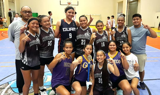 The Crusaders Grey claimed the title in the Under-18 Girls Division Wednesday at the Guam Sports Complex Gym.