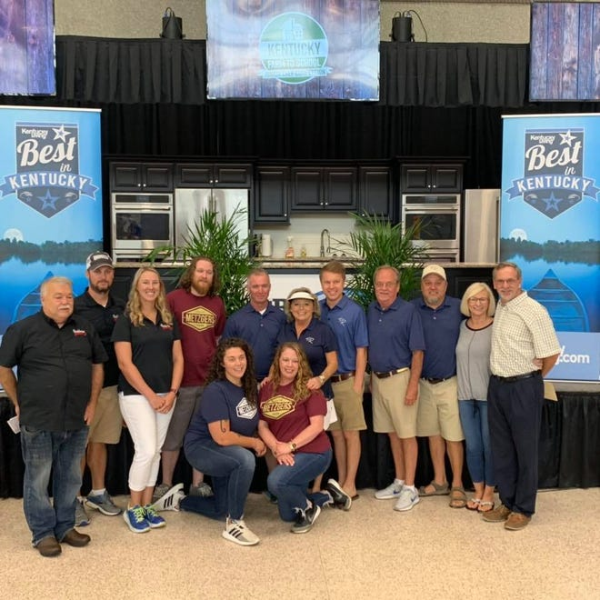 "Some of  the Henderson business owners who earned awards in Kentucky Living magazine's ""Best in Kentucky"" ranking gather for a group photo Thursday at the Kentucky State Fair."