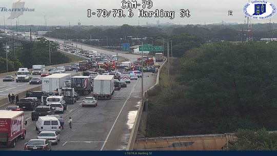 A multi-vehicle crash has shut down I-70 near Harding Street.
