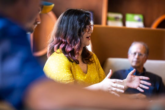 Erica Cole, founder of No Limbits, asks a questions while U.S. Rep. Dave Loebsack, D-Iowa, meets with local entrepreneurs during a Congressional Start Up Day event, Thursday, Aug. 22, 2019, at MERGE, a coworking space, in downtown Iowa City, Iowa.