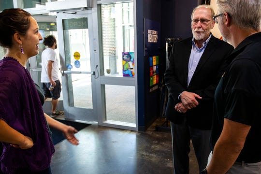 U.S. Rep. Dave Loebsack, D-Iowa, talks with Liz Hubing, left, and Mark Nolte, right, of the Iowa City Area Development Group before meeting with local entrepreneurs during a Congressional Start Up Day event, Thursday, Aug. 22, 2019, at MERGE, a coworking space, in downtown Iowa City, Iowa.