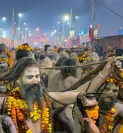 This chaotic photo by Bobby Jett enhanced with Lightroom software shows a crowd of long-haired Sadhus holy men heading for the Ganges River in Prayagraj, India to bathe during what has been called the largest religious festival in the world.