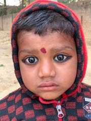 This timid child with enormous eyes was one of many subjects photographed by Bobby Jett during his trip to India last October.