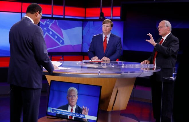 Former Mississippi Supreme Court Chief Justice and Republican gubernatorial candidate Bill Waller Jr., right, answers a question from WJTV co-anchor Byron Brown, left, during a GOP gubernatorial runoff debate against Lt. Gov. Tate Reeves, center, in Jackson, Miss., Wednesday, Aug. 21, 2019.