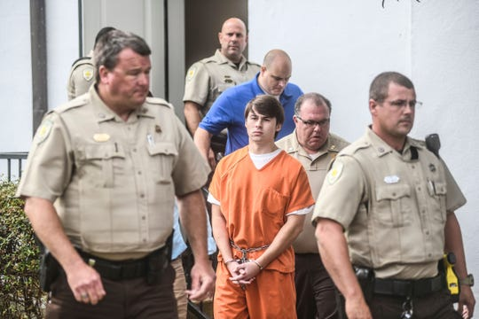 """Brandon Theesfeld, center, leaves the Lafayette County Courthouse in Oxford, Miss. on Aug. 22, following a hearing in connection with the death of Alexandria """"Ally"""" Kostial of St. Louis, Mo. On Friday, Aug. 30, he was charged with capital murder."""