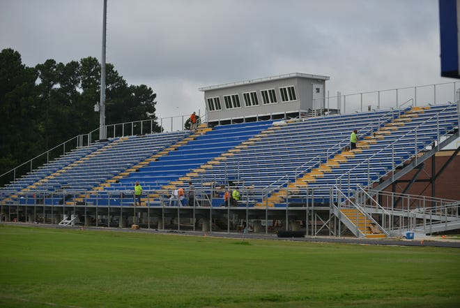 Crews continue to finish up on the home side of the stadium at North Side High School on Thursday.