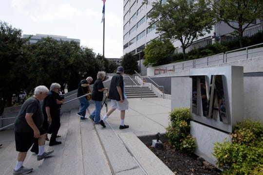 Supporters for Kingston coal ash workers make their way to the TVA headquarters to address the TVA board on Wednesday, August 21, 2019