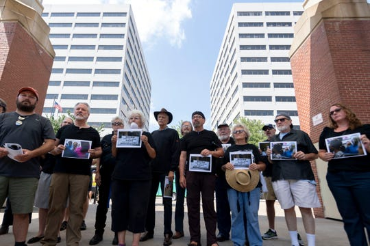Supporters for Kingston coal ash workers gather for a silent protest at Market Square below the TVA towers on Wednesday, August 21, 2019