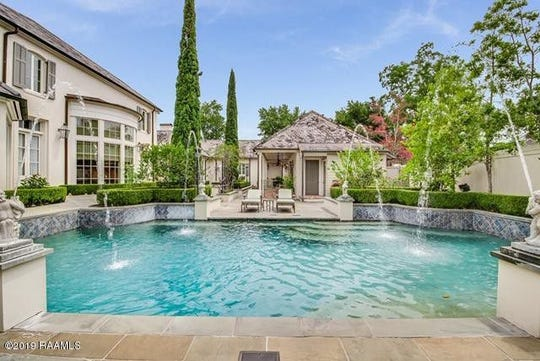 Greenbriar Estates mansion is the most expensive home on the market for $4.9 million. The 8,580 square foot home includes two outbuildings, a pool with fountains, a theater room and much more.