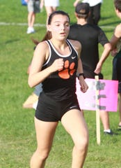 Katie Carothers was 13th in the regional cross country meet last year.