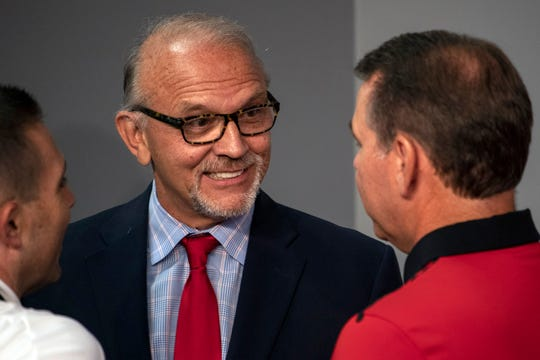 Norton Healthcare CEO Russ Cox spoke with UofL athletic director Vince Tyra during an announcement of a partnership between the university and medical provider on Thursday afternoon. 8/22/19