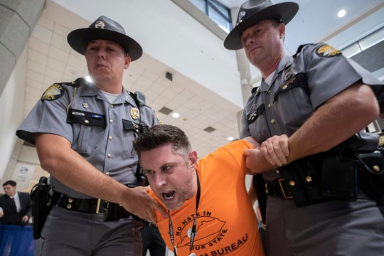 Fairness Campaign executive director Chris Hartman is handcuffed and carried out by State Troopers after being denied entry into the Kentucky Farm Bureau Ham Breakfast following his protest accusing Kentucky Farm Bureau of discriminatory policies. Aug. 22, 2019