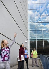 From left.  Lindsay Ross, Linnea Rowse, Barb Saxena, Lindsay Ross, and Julie Hupp look up at windows on Constitution Hall in downtown Lansing Thursday morning, Aug. 22, 2019, during a bird monitoring expedition in downtown Lansing.  Michigan Audubon Society volunteers count bird-window collisions in downtown Lansing and at the MSU campus