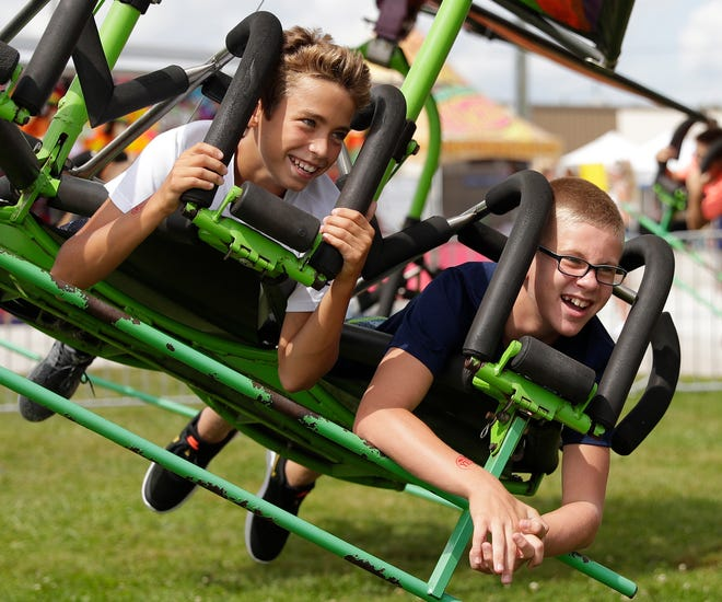 Kids ride the Cliff Hanger at the Manitowoc County Fair on Aug. 21, 2019 in Manitowoc, Wis.