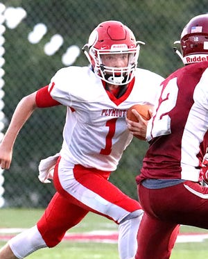 Plymouth's Walker Elliott runs the football against Willard last season. The Big Red meet the Flashes in Week 2 in 2019.