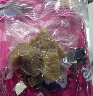 Mansfield Police conducted a controlled delivery Thursday of 111 grams of MDMA that was sent from Belgium and to 231 West Fifth St.