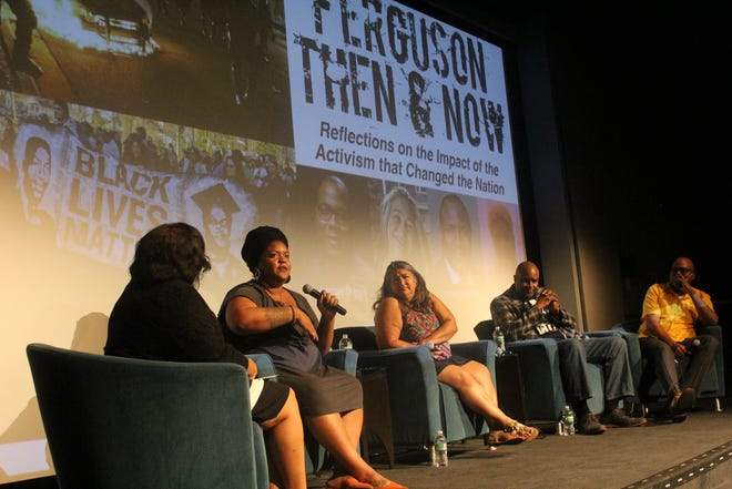 "Victoria Jones (second to left) speaks during a panel discussion entitled ""Ferguson Then & Now."" Other speakers pictured are Elizabeth Vega (middle), Andre Johnson (second right), and Jimmie Briggs (far right)."