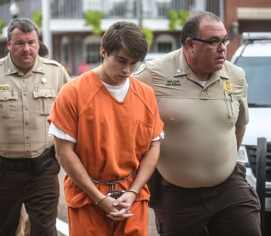 "Brandon Theesfeld is led into the Lafayette County Courthouse in Oxford, Miss., for a bond hearing in connection with the death of a University of Mississippi student, Thursday, Aug. 22, 2019.  Theesfeld is charged with murder in the death of 21-year-old Alexandria ""Ally"" Kostial.  (Bruce Newman/The Oxford Eagle via AP)"