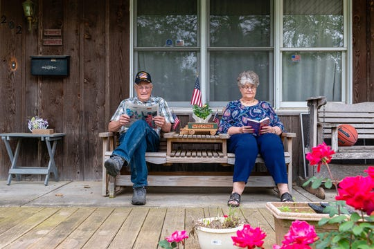 "Lewis Bybee, a retired veterinarian and I-70 Community Hospital board member, and his wife, Janice, on their porch in Sweet Springs, Mo. ""All he did was take from us,"" Lewis says of Jorge A. Perez."