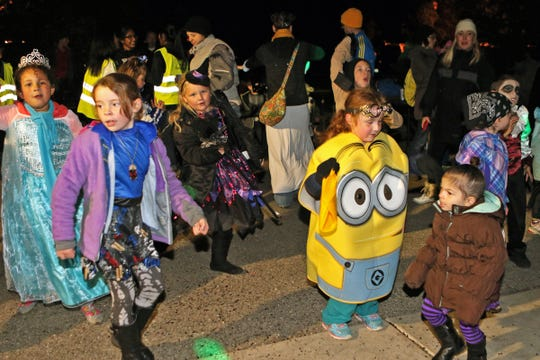 Kids in costume dance at Retzer Nature Center during its annual Howl-o-Ween event.