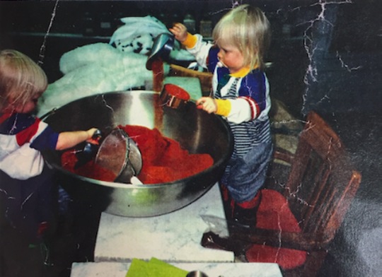 Caitlin PenzeyMoog is pictured in an old photo making Peace Climb Chili Powder at her grandparents' store, The Spice House in Wauwatosa.