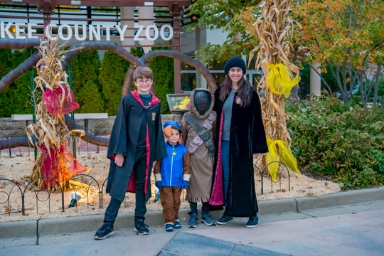 Visitors in costume pose for pictures at the 2018 Boo at the Zoo.