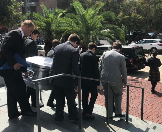 Former Louisiana Gov. Kathleen Blanco's body is taken from St. Joseph Cathedral Thursday, Aug. 22, 2019, before being taken to the Capitol to lie in state.