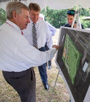 Montgomery Mayor Todd Strange, left, and City Councilman Richard Bollinger unveil an artists rendering of the new Screws Park on Atlanta Highway in Montgomery, Ala., during a groundbreaking ceremony on Thursday August 22, 2019.