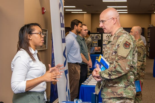 Joyce Vaughn, an MGMWERX representative, speaks with Col. Scott Bryant, 42nd Mission Support Group commander, during Air University's wing commander orientation Aug. 13, 2019, on Maxwell Air Force Base, Alabama.