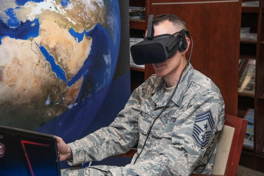 Chief Master Sgt. Lee Mills, 673rd Air Base Wing command chief from Joint Base Elmendorf-Richardson, Alaska, tests out virtual reality Aug. 13, 2019, during the Air University wing commander's orientation on Maxwell Air Force Base, Alabama.