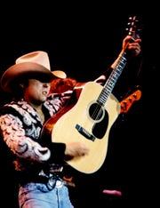 Honky-tonk champion Dwight Yoakam finishes up one of his hit songs for nearly 10,000 fans at Starwood Amphitheatre on Aug. 19, 1989. Yoakam, Clint Black and headliners The Judds kept the fans entertained.