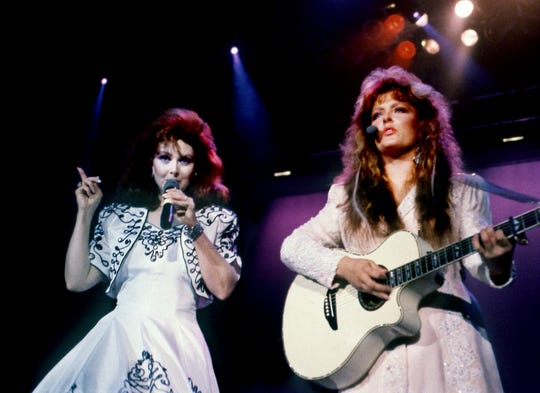 "Mother Naomi, left, and daughter Wynonna of The Judds kick off their performance at Starwood Amphitheatre on Aug. 19, 1989, with the bluesy hit tune ""I Know Where I'm Going."" The Judds topped a bill that also included stars Dwight Yoakam and Clint Black."