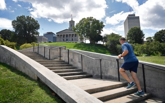 A runner uses the steps leading up to the Tennessee state Capitol for his exercise Thursday, Aug. 22, 2019, in Nashville, Tenn.