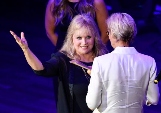 Barbara Mandrell delivers the ACM Poet's Award to Kye Fleming at the 13th Annual ACM Honors at the Ryman  Wednesday, Aug. 21, 2019, in Nashville, Tenn.