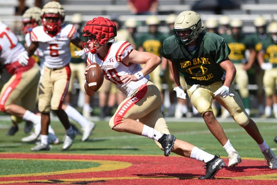 Bergen Catholic High School and Red Bank Catholic football held a scrimmage at Bergen Catholic in Oradell on August 22, 2019. Bergen Catholic quarterback Steven Angeli #10 gains yards. Bergen Catholic defeated Red Bank 26-0.