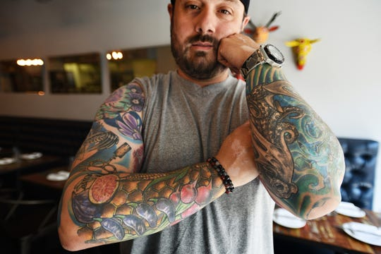 Photo of Mike Carrino, former chef of Pig and Prince and Passionein, showing his tattoos, photographed in Montclair.  He is the chef and owner of the new Mike's Pasta and Sandwich Shoppe in Nutley.