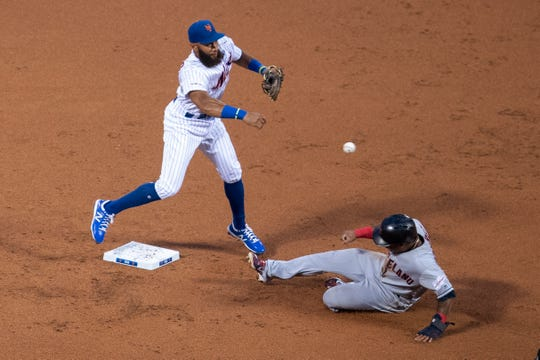 New York Mets' Amed Rosario throws to first after forcing out Cleveland Indians' Jose Ramirez during the second inning of a baseball game Wednesday, Aug. 21, 2019, in New York. Jason Kipnis was out at first.  (AP Photo/Mary Altaffer)