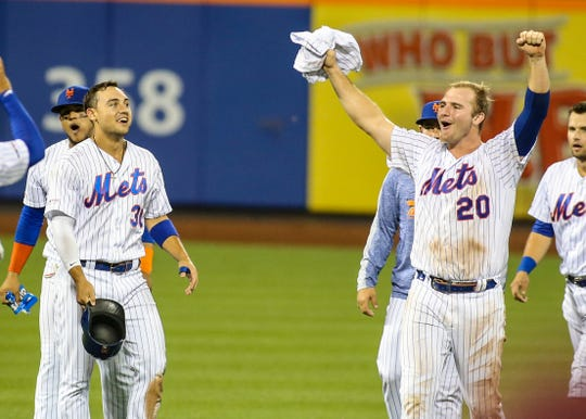 Aug 21, 2019; New York City, NY, USA; New York Mets first baseman Pete Alonzo (20) and right fielder Michael Conforto (30) celebrate after defeating the Cleveland Indians in ten innings at Citi Field. Mandatory Credit: Wendell Cruz-USA TODAY Sports