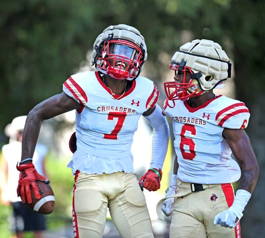 Bergen Catholic High School and Red Bank Catholic football held a scrimmage at Bergen Catholic in Oradell on August 22, 2019. Bergen Catholic Amar Gist #7 celebrates his touchdown catch with Rakem Ross #6 in the first half. Bergen Catholic defeated Red Bank 26-0.