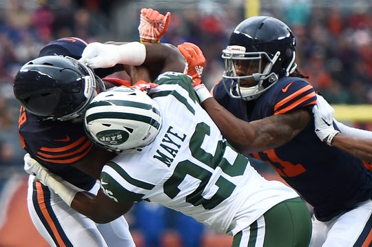 Anthony Miller #17 of the Chicago Bears is tackled by Marcus Maye #26 of the New York Jets in the first quarter at Soldier Field on October 28, 2018 in Chicago, Illinois.