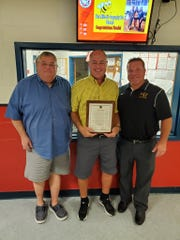 Greg Bailey, center, joined by former West Milford athletic director Tim Gillen, left, and current athletic director Joe Trentacosta.